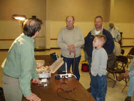Jack Dennis Talking with Club Members during a break in the Fly Tying Demonstration