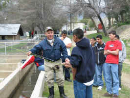 Club Member giving casting instructions during Trout in the Classroom outing